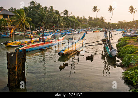 Horizontal view of fishing boats moored in Dodanduwa, Sri Lanka. - Stock Photo