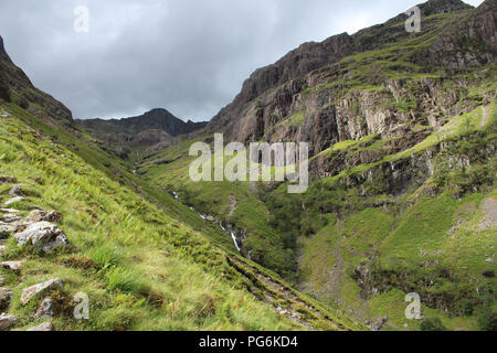 Walking the famous Three Sisters of Glencoe, Scotland. In the beautiful Scottish Highlands. View from the track up Coire nan Lochan, with Aonach Dubh  - Stock Photo
