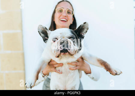 Young woman showing her dog - Stock Photo