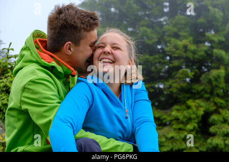 Happy young couple in nature - Stock Photo