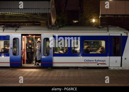 Rail commuters on a Chiltern railways train at London Marylebone in the evening rush hour - Stock Photo