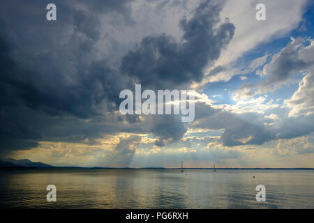 Germany, Bavaria, Chiemgau Alps, Chieming at Chiemsee, dark clouds over Lake Chiemsee - Stock Photo