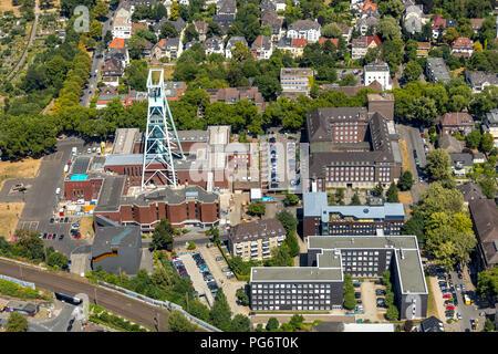 Deutsches Bergbau-Museum Bochum, Doppelbock Förderturm, Bochum, Innenstadt, Ruhrgebiet, Nordrhein-Westfalen, Deutschland, DEU, Europa, Luftbild, birds - Stock Photo