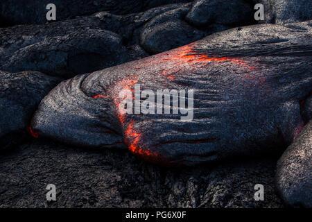 USA, Hawaii, Big Island, Volcanoes National Park, lava flowing from Pu'u O'o' volcano - Stock Photo