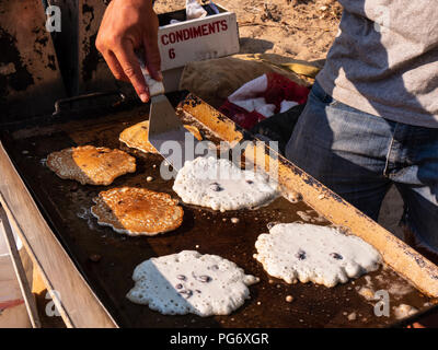 Pancakes on the griddle, Range Creek campsite, Gray Canyon north of Green River, Utah. - Stock Photo