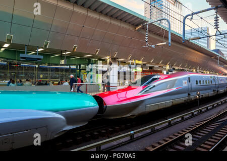 TOKYO, JAPAN - APRIL 21 2018: Japanese Shinkansen high speed train Hayabusa (left) and Komachi (right) join together travel up north east of Japan fro - Stock Photo