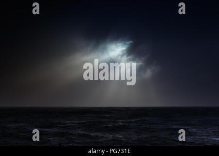 Dark overcast sea full moon night before storm. Used digital filter. - Stock Photo