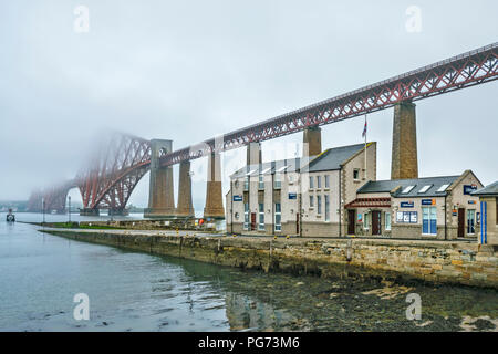 RNLI BUILDINGS SOUTH QUEENSFERRY UNDER THE FORTH RAILWAY BRIDGE SCOTLAND ON A MISTY MORNING - Stock Photo