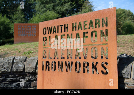 Sign outside the historic Blaenavon Ironworks museum, part of the Blaenavon UNESCO World Heritage Site in Wales, UK - Stock Photo