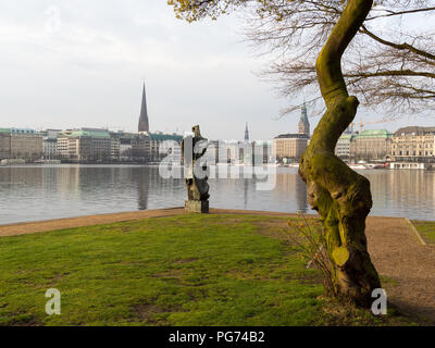 Hamburg, Germany - April 14, 2016: View at sculpture named 'Windsbraut', whirlwind, Binnenalster Ballindamm, Jungfernstieg and Town Hall in background - Stock Photo