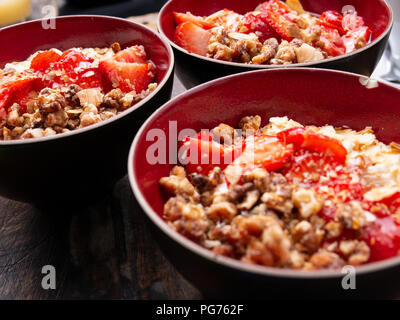 Healthy breakfast: muesli, fresh fruit and figs in bowls - Stock Photo