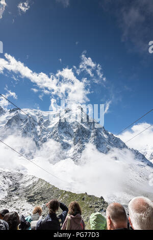 People are waiting for arrival of cable-car to the peak of mountain Mont Blanc, Chamonix, France - Stock Photo