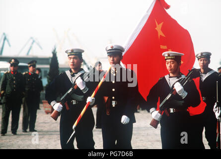 Members of a Chinese color guard armed with Type 56 assault rifles march in review during the first visit by US Navy ships to China in 40 years. - Stock Photo
