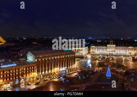 Saint Petersburg, Russia - January 6, 2018: View of St. Isaac's square from the colonnade of St. Isaac's Cathedral at night - Stock Photo