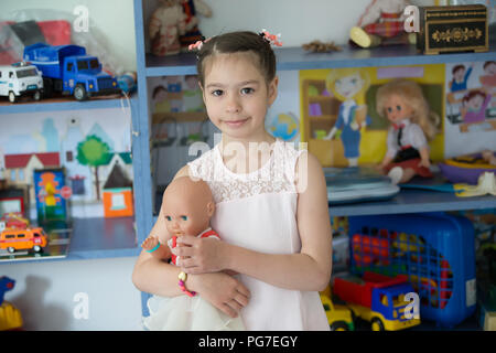 Belarus, Gomel, May 30, 2018. The central kindergarten. Open day.A preschool girl in a kindergarten with a doll - Stock Photo