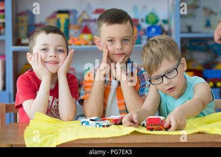 Belarus, Gomel, May 30, 2018. The central kindergarten. Open day.Children play with cars in the kindergarten. Boys preschoolers friends - Stock Photo