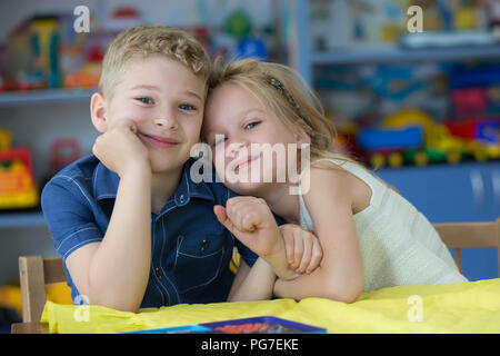 Belarus, Gomel, May 30, 2018. The central kindergarten. Open day.Beautiful boy and girl in kindergarten. Children are preschoolers. Little brother and - Stock Photo