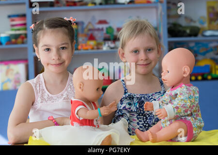 Belarus, Gomel, May 30, 2018. The central kindergarten. Open day.Pre-school girls in kindergarten play with dolls - Stock Photo