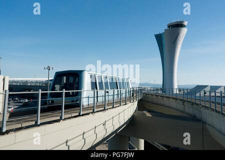 San Francisco International Airport air traffic control tower and AirTrain - San Francisco, California USA - Stock Photo