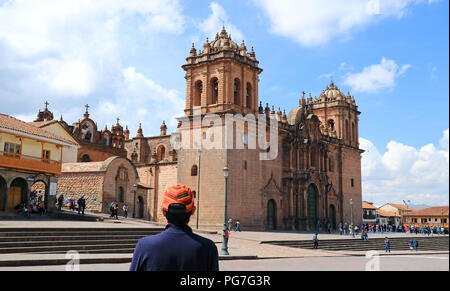 Young Tourist Admiring the Marvelous Cusco Cathedral on Plaza de Armas, Cusco, Peru, South America - Stock Photo