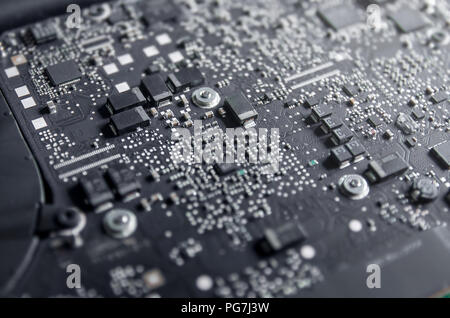 Close-up of circuit board and electronic computer hardware, Repairing technology of computer and laptop, Repair of electronic control panel, motherboa - Stock Photo