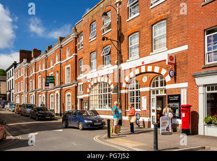 UK, England, Devon, Crediton, Market Street, customers outside town Post Office in Edwardian building - Stock Photo
