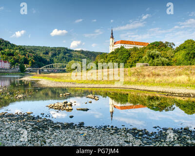 Dry riverbed of river Elbe in Decin, Czech Republic, summer 2018. Empty river bed with poisoned muddy water. Decin castle above old railway bridge. - Stock Photo