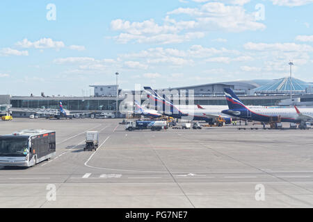 Moscow, Russia - May 30, 2018: Sheremetyevo international airport. Infrastructure, airplanes waiting on terminal gates for passenger. - Stock Photo