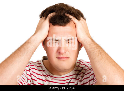 A young hipster guy wearing white and red shirts, holding hands on his head, desperately closing his eyes to cry, bad news. man having problems. emoti - Stock Photo