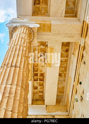 Doric column and restored architrave detail of eastern facade of Propylaea, the ancient gateway to the Athenian Acropolis. Athens. Attica, Greece. - Stock Photo