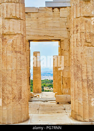 Propylaea, the ancient gateway to the Athenian Acropolis, with the city of Athens in background. Attica, Greece. - Stock Photo