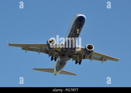 A British Airways CityFlyer Embraer 190 comes in to land at London City Airport in London's Docklands - Stock Photo