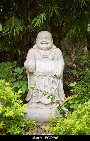 Vietnam, Buddha statue in a garden setting on the Marble Mountains ...