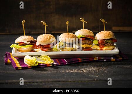 Mini burger on plate - Stock Photo