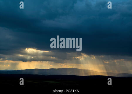 Germany, dark and dramatic cloudy mood during thunderstorm - Stock Photo