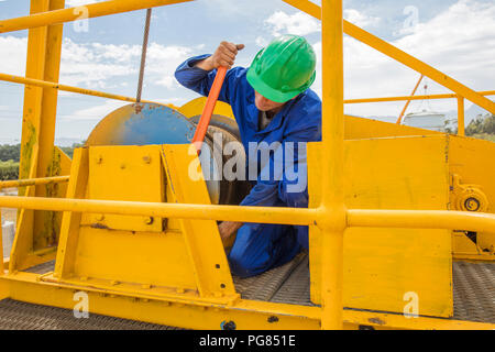 Construction worker working on crane - Stock Photo