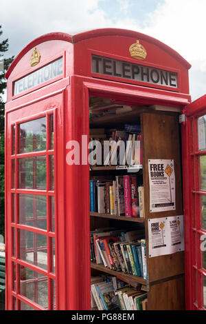 A UK red telephone box used to house the book sharing scheme BookCrossing in Barga, Tuscany, Italy, Europe - Stock Photo