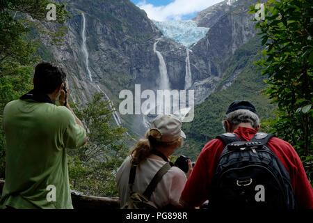 Tourists photographing the Ventisquero colgante (hanging glacier).Queulat National PArk.Aysén region.Chile - Stock Photo