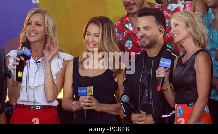 New York City, New York, USA. 24th Aug, 2018. GMA co-hosts LARA SPENCER, GINGER ZEE, and AMY ROBACH and singer LUIS FONSI at his performance on 'Good Morning America' in Central Park. Credit: Nancy Kaszerman/ZUMA Wire/Alamy Live News - Stock Photo