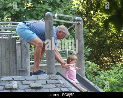 New York, USA. August 24, 2018 - New York, New York, U.S. - Hall of Fame Quarterback John Elway with family in New York's Central Park. John plays with child in playground. Credit: Bruce Cotler/Globe Photos/ZUMA Wire/Alamy Live News - Stock Photo