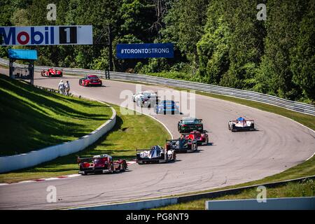 Bowmanville, CAN., 08 Jul 2018. 8th July, 2018. The field makes their way through the inconsequential turn 6 on 08 of July, 2018 at Canadian Tire Motorsport Park during the Mobil 1 SportsCar Grand Prix weekend. Credit: Victor Biro/ZUMA Wire/Alamy Live News - Stock Photo