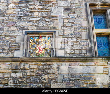 The Royal Coat of Arms of Scotland is displayed on the exterior wall of the Great Hall, Edinburgh Castle, Edinburgh, Scotland - Stock Photo