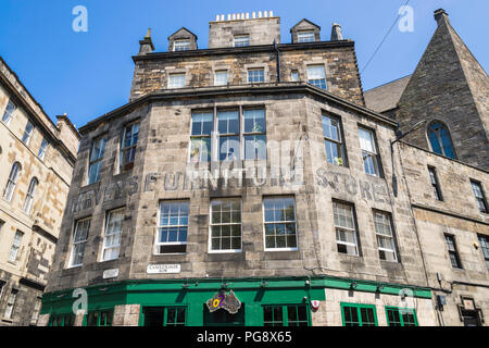 The former Harvey's Furniture Stores in Candlemaker Row, Edinburgh, Scotland, is now a popular Australian bar. - Stock Photo