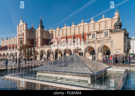 The fountain near the beautiful Cloth Hall in the historic center of Krakow, Poland - Stock Photo