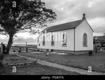 COUNTY DONEGAL, IRELAND - AUGUST 12th 2018: A black and white photograph of St Crone's Church of Ireland, Dungloe. - Stock Photo