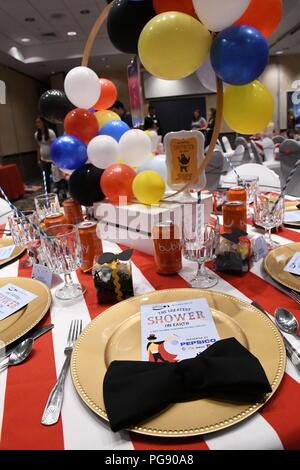"""The Commons ballroom was decorated in a circus theme Aug. 22 as 39 expectant mothers at Fort Drum were invited to an exclusive baby shower. Hosted by the non-profit Operation Shower with the theme """"The Greatest Shower on Earth,"""" attendees were treated to a pasta and pizza lunch, shower games, raffles and more. (Photo by Mike Strasser, Fort Drum Garrison Public Affairs) - Stock Photo"""