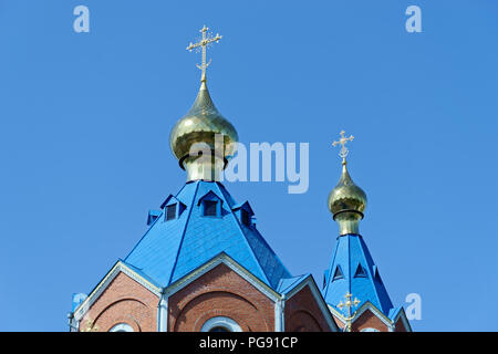 Blue roofs of russian orthodox church against clear blue sky. Cathedral of Our Lady of Kazan in Komsomolsk-on-Amur in Russia - Stock Photo