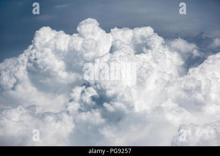 A layer of clouds seen from  very high altitude. Cloud from above. - Stock Photo