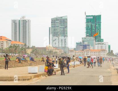 people relaxing on beachfront Galle Face Green in Colombo, Sri Lanka on November 2013. - Stock Photo