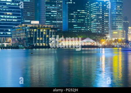 SINGAPORE - 27 Oct 2015: the Fullerton Bay hotel is seen across the Marina Bay in Central Business District, Singapore. - Stock Photo